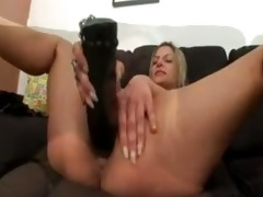 golden-haired takes huge dark sextoy and a fist