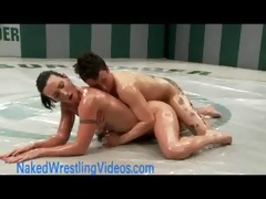 beefy lesbos wrestling oiled bodies
