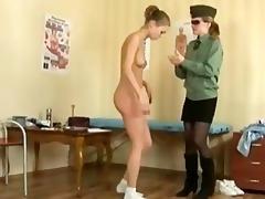 aged doctor examining teen