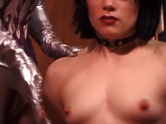 glamorous juvenile brunette is restrained and