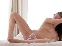 brunett hottie teasing and posing on daybed