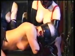 lesbo latex servitude with ding-dong