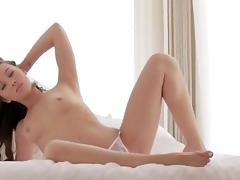 brunette hair playgirl finger and posing on daybed