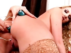 excited lesbian babes play with sex toys in